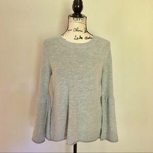 Kenzie NWOT hi-lo sweater with bell sleeves. Grey